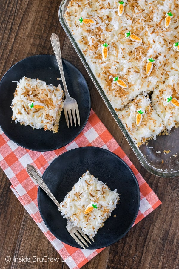 Loaded Carrot Cake - this easy cake is full of coconut, raisins, spices, and pineapple. Great cake recipe for Easter dinner!
