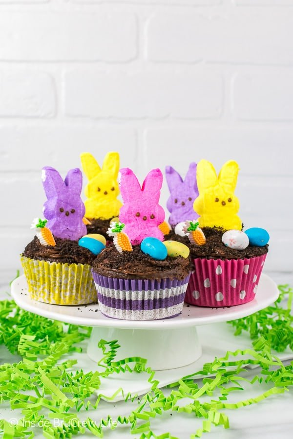 Easter Dirt Cupcakes - a hidden pudding center and marshmallow bunnies make these easy cupcakes disappear in a hurry. Great Easter party recipe!