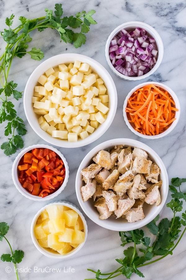 Pineapple Sriracha Chicken Salad - fresh veggies and a sweet and spicy dressing make this salad recipe a keeper!