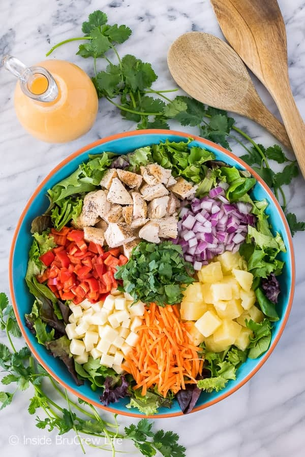 Pineapple Sriracha Chicken Salad - the homemade dressing gives this easy dinner salad a sweet and spicy kick! Great healthy dinner recipe for hot summer days!