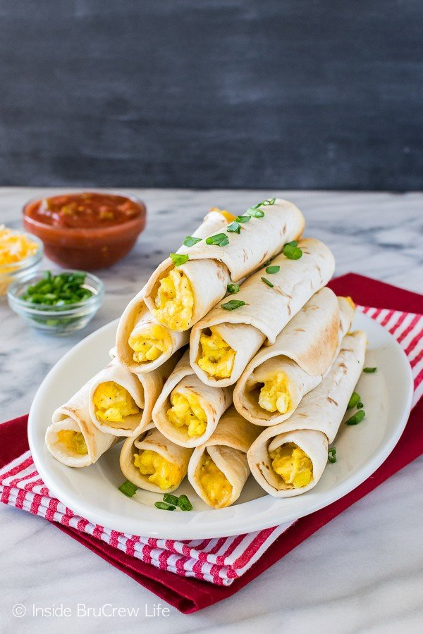 Green Chile Egg Taquitos - cheesy eggs and green chiles makes a great grab and go breakfast recipe.