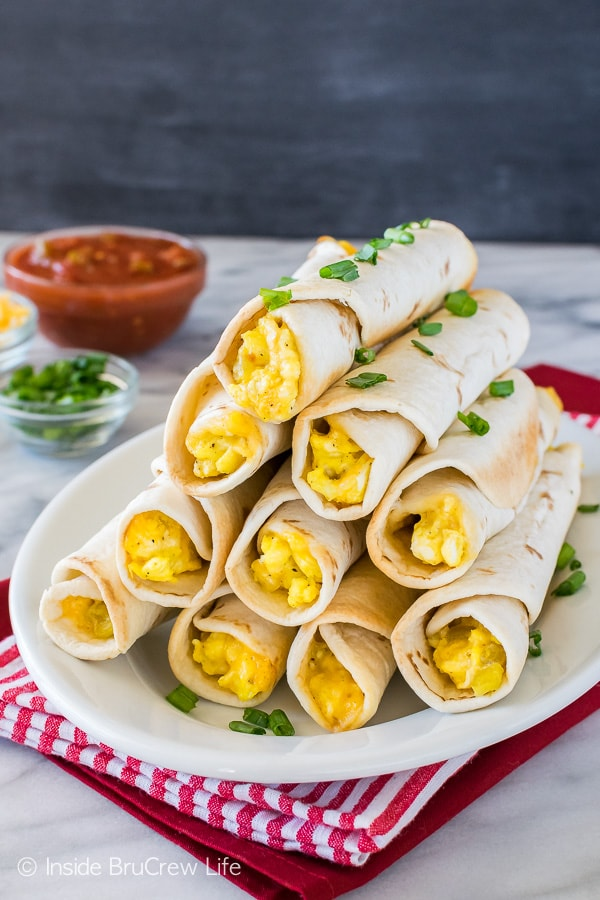 Green Chile Egg Taquitos - tortillas filled with eggs, cheese, and green chiles is a great breakfast. Make this recipe ahead to save time in the morning.