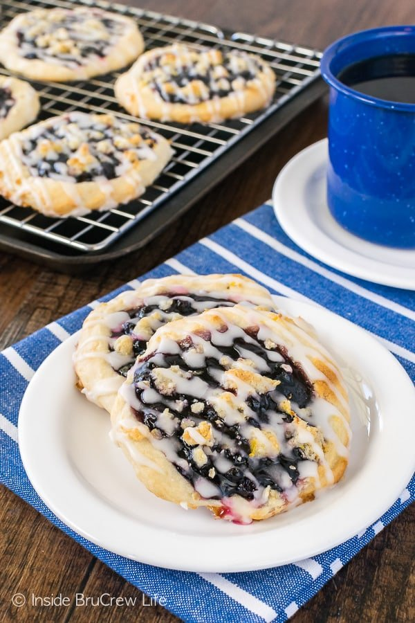 Homemade Blueberry Lemon Danish - blueberry pie filling and lemon drizzles makes these easy breakfasts disappear in a hurry! Great recipe to make for weekend brunches!