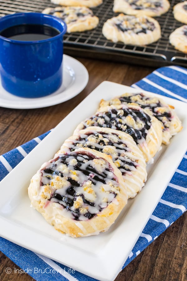 Homemade Blueberry Lemon Danish - a lemon crumble and glaze adds a fresh twist to these easy blueberry pastries. Easy recipe for breakfast or brunch!