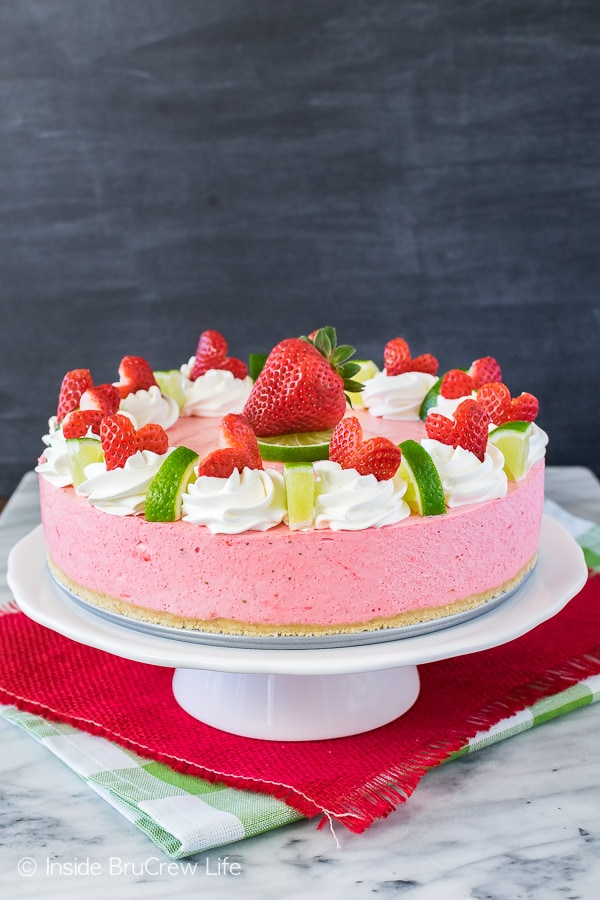 No Bake Strawberry Daiquiri Cheesecake - this soft and fluffy cheesecake is loaded with strawberry and lime flavor! Easy no bake dessert for summer parties or picnics!