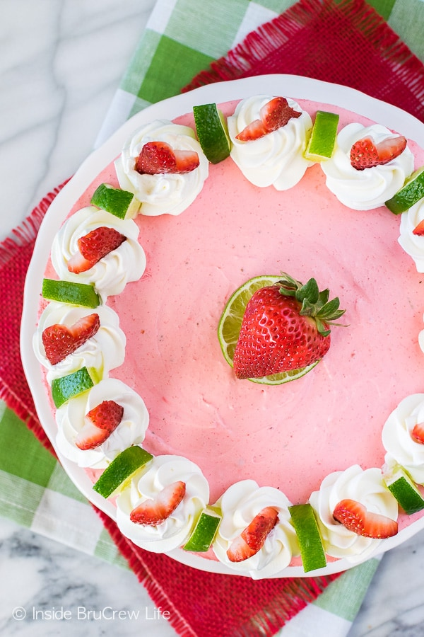 No Bake Strawberry Daiquiri Cheesecake - this light and fluffy cheesecake is loaded with strawberry and lime! Easy no bake dessert recipe for summer!