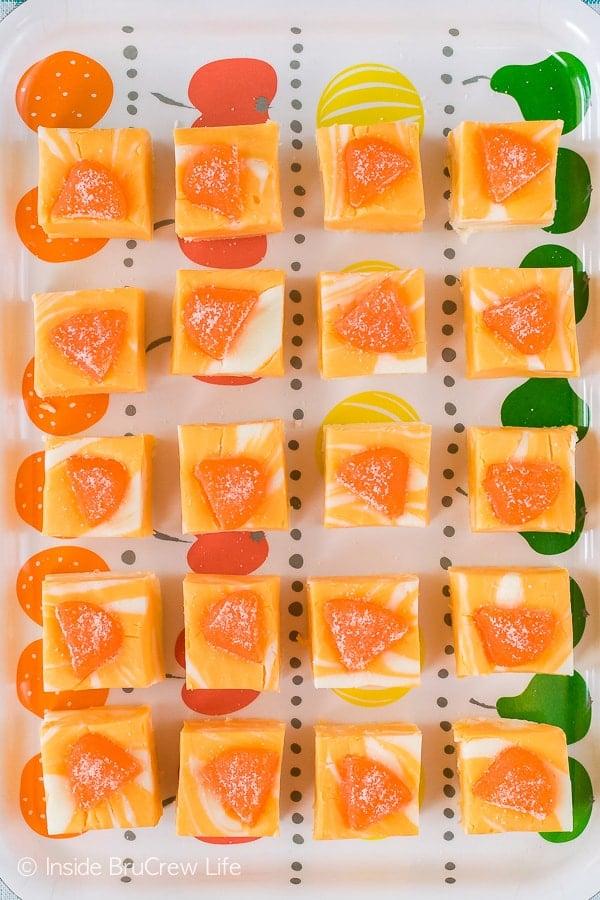 No Fail Orange Creamsicle Fudge - orange and white fudge swirls make this easy no bake recipe a fun summer dessert.