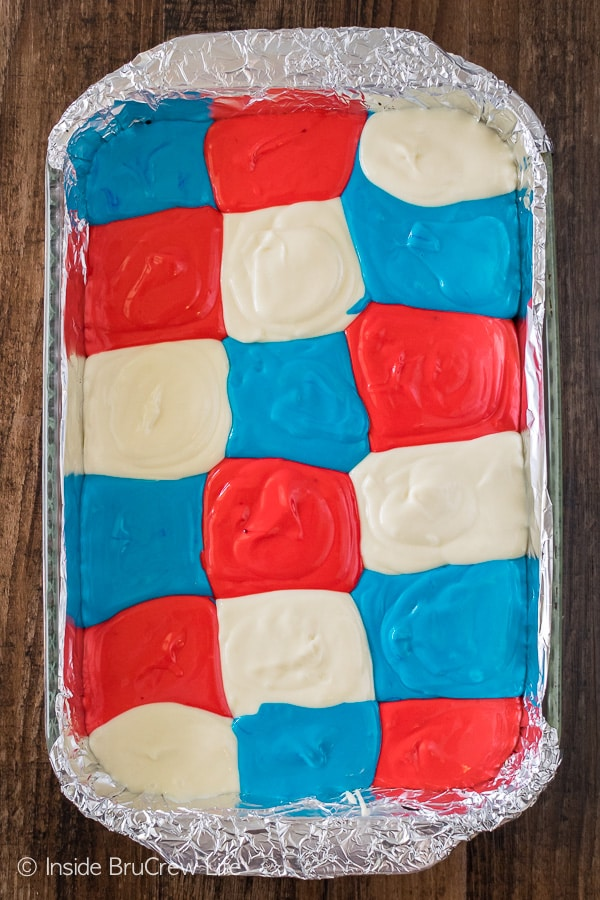 A pan of red white and blue cheesecake batter