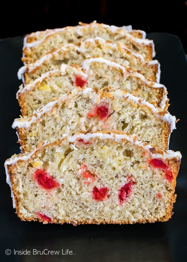 Tropical Banana Bread - this easy sweet bread is loaded with pineapple, coconut, and cherries. Great recipe to use up the ripe bananas on your counter!