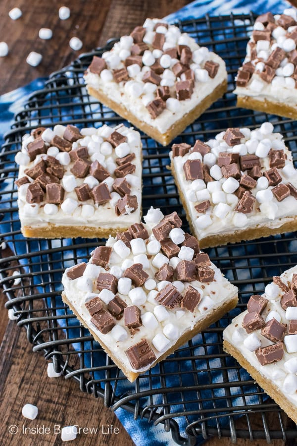 S'mores Sugar Cookie Bars - marshmallow frosting, chocolate chunks, and graham cracker cookies make these a fun summer treat!