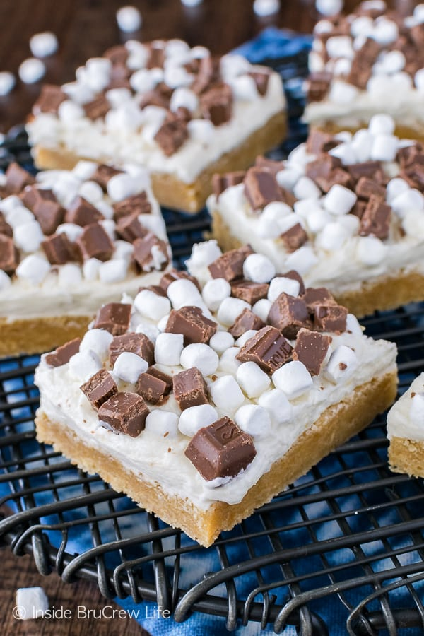 S'mores Sugar Cookie Bars - a sweet graham cracker flavored cookie topped with chocolate and marshmallow is the perfect recipe for summer picnics!