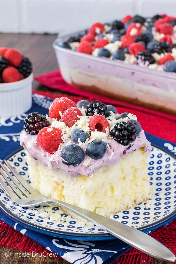 White Chocolate Berry Pudding Cake - a sweet berry topping, fresh berries, and pockets of pudding make this a fun summer recipe. Easy dessert to make for parties and picnics!
