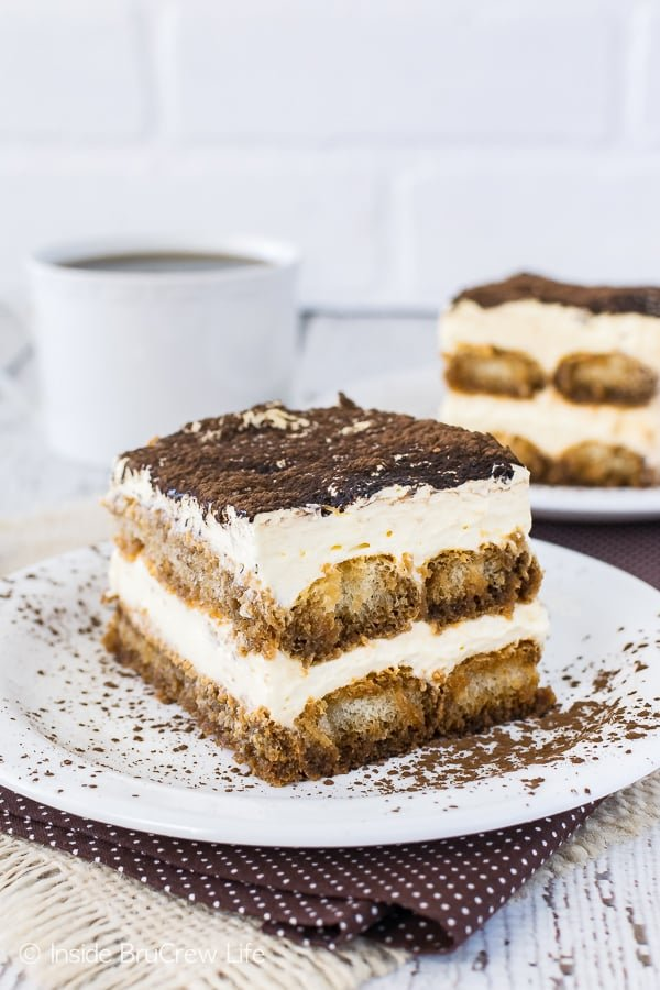 Easy Tiramisu - coffee soaked cookies layered with a creamy no bake cheesecake makes an impressive dessert. Great recipe for summer picnics or fancy dinner parties!