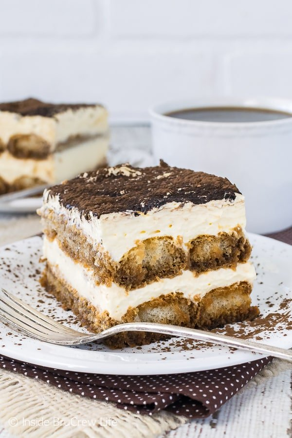 Easy Tiramisu - layers of creamy cheesecake and coffee soaked cookies make this an easy and impressive no bake dessert. Great recipe for fancy dinner parties or summer picnics!