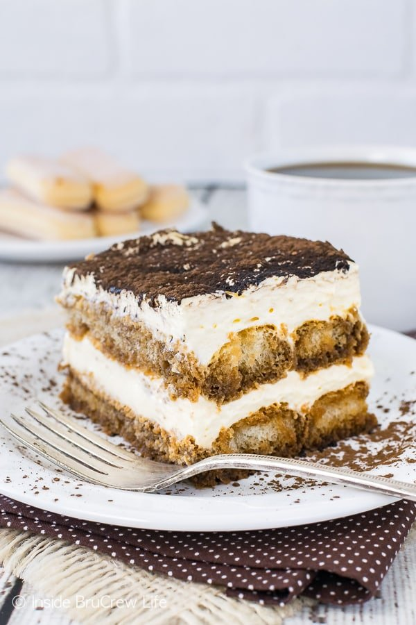 Easy Tiramisu - coffee soaked cookies layered with a no bake cheesecake makes a fast but impressive dessert. Easy recipe for summer picnics or fancy dinner parties!