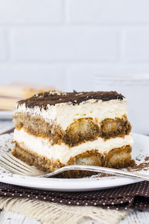 Easy Tiramisu - layers of creamy no bake cheesecake and coffee soaked cookies make an awesome quick dessert. Great recipe to share at summer picnics or fancy dinner parties!
