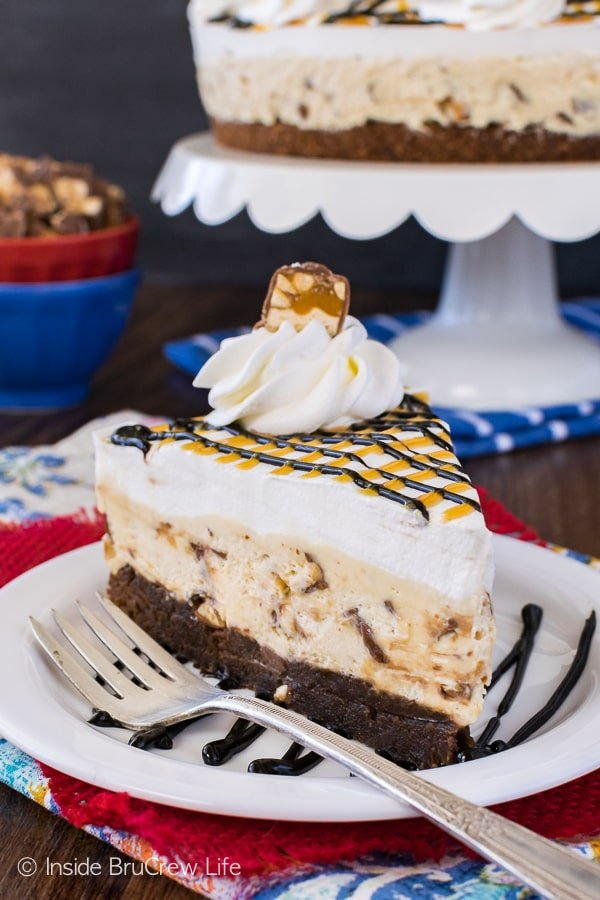 Snickers Cheesecake Brownie Cake - layers of chewy brownies and candy loaded cheesecake make this a fun recipe to serve after dinner. Easy dessert for any party!