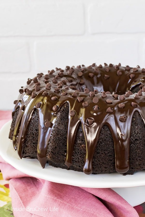 Ultimate Chocolate Zucchini Bundt Cake - this rich and moist zucchini cake is loaded with three kinds of chocolate. Perfect recipe to use up those extra veggies!