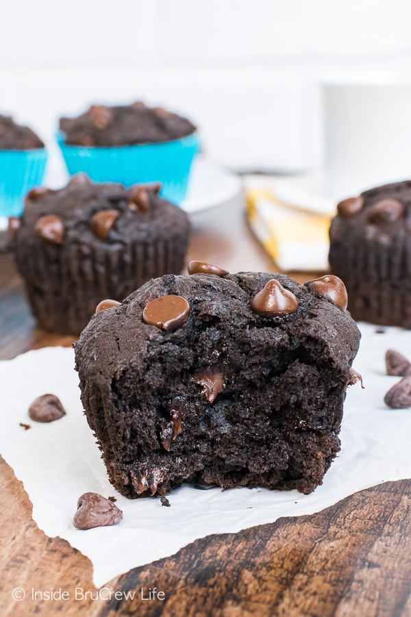 Dark Chocolate Banana Muffins - these rich and gooey muffins are loaded with banana and dark chocolate. Great breakfast muffin recipe for busy mornings!