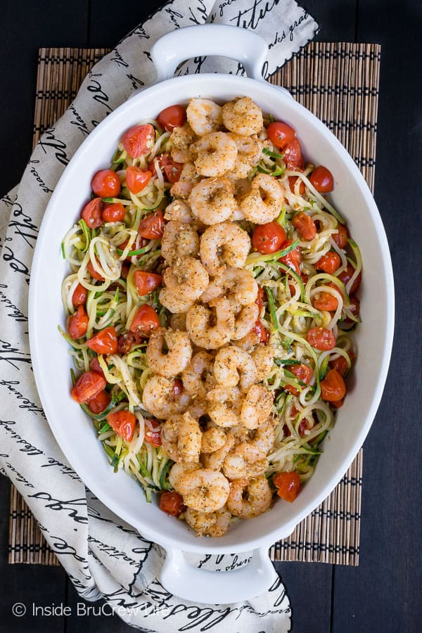 Parmesan Garlic Shrimp Zucchini Noodles - this easy lean and green meal is loaded with veggies and baked shrimp. Great dinner recipe for when you are eating healthy! #leanandgreen #healthy #shrimp #30minutemeal #zucchini