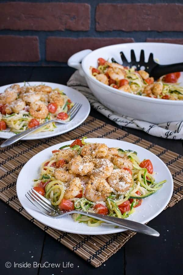 Parmesan Garlic Shrimp Zucchini Noodles - this easy dish is loaded with zucchini, tomatoes, and parmesan garlic baked shrimp. Great lean and green meal to enjoy when you are eating healthy. #leanandgreen #healthy #shrimp #30minutemeal #zucchini