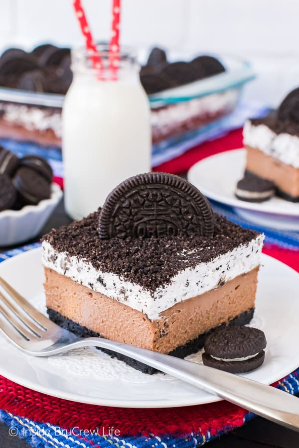 Chocolate Cookies and Cream Cheesecake Bars - creamy chocolate cheesecake and a cookies and cream mousse make this recipe disappear in a hurry