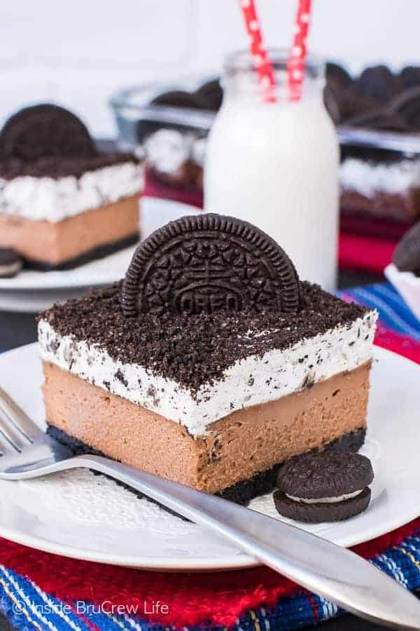 Chocolate Cookies and Cream Cheesecake Bars - four layers of chocolate and cookie goodness in every single bite. Great cheesecake recipe that everyone will love!
