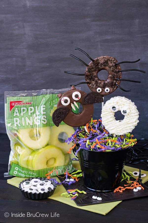 Chocolate Dipped Halloween Apple Rings - candy eyes and cookies add a fun twist to these chocolate dipped apples. Easy no bake recipe for Halloween parties!