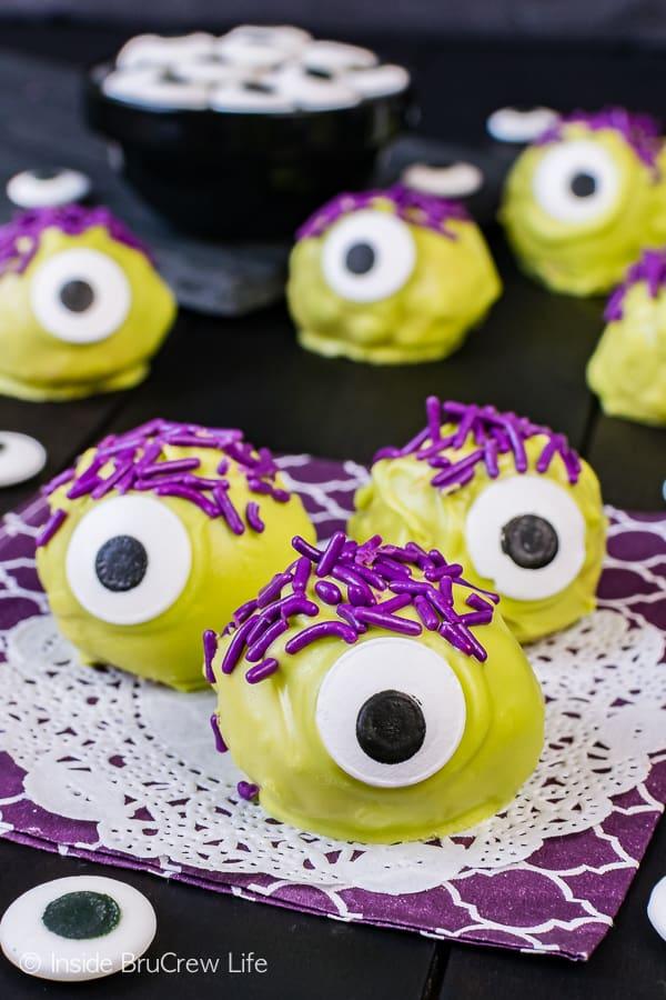Peanut Butter Monsters - green candy melts, purple sprinkles, and candy eyes turn these easy candies into a fun halloween treat. Easy no bake recipe!