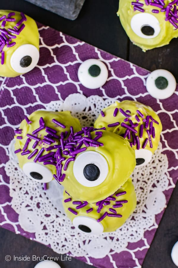 Peanut Butter Monsters - a big candy eye and purple sprinkles make these easy no bake candies so fun. Easy recipe for halloween parties!