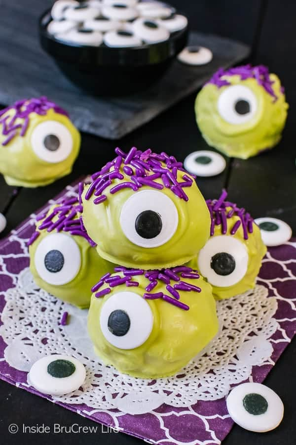 Peanut Butter Monsters - big candy eyes and purple hair make these easy no bake treats a fun and easy recipe to make for halloween parties!