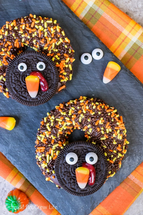 Chocolate Covered Apple Ring Turkeys - candies and cookies turn apple rings into the cutest turkeys. Great no bake recipe for kids to make on Thanksgiving day!