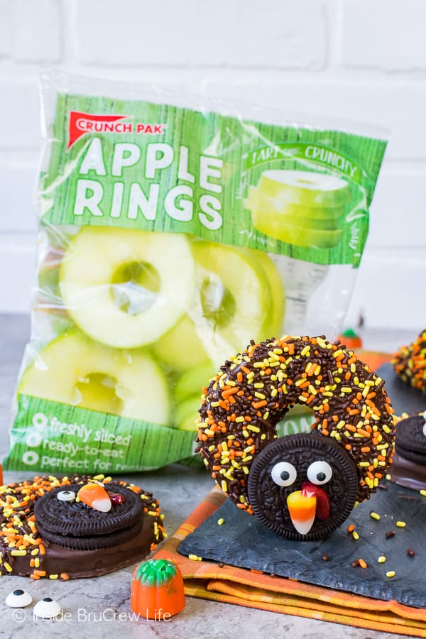 Chocolate Covered Apple Ring Turkeys - cookies and sprinkles transform these apple rings into cute turkeys. Easy no bake recipe for Thanksgiving day!