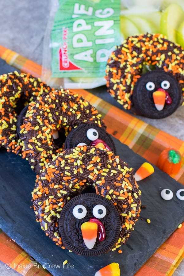 Chocolate Covered Apple Ring Turkeys - fall sprinkles, cookies, and candies turn apples into cute turkeys. Great no bake recipe for Thanksgiving day!