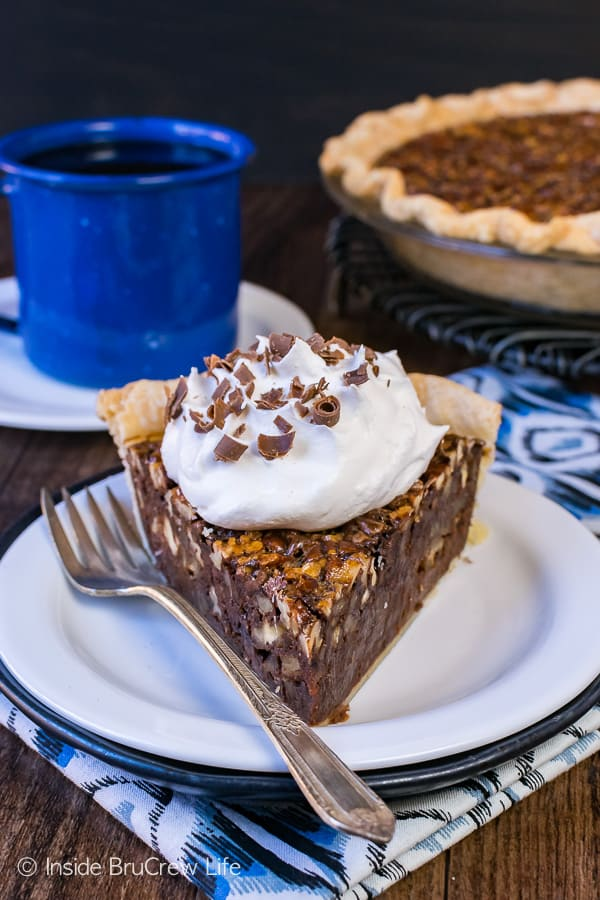 Chocolate Fudge Pecan Pie - a gooey fudge layer and toasted nuts make this one amazing pie. Easy recipe to make for Thanksgiving day dinner!