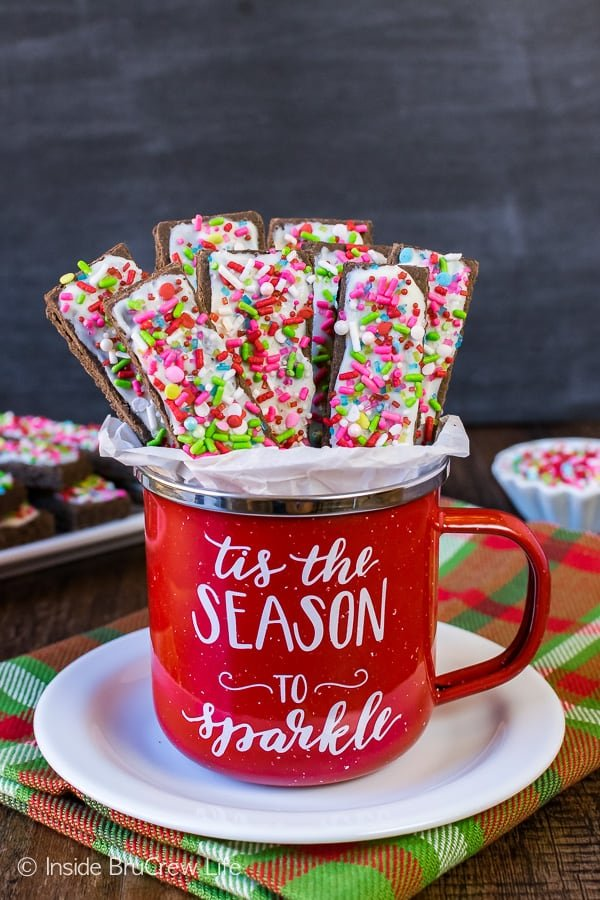 Frosted Mocha Shortbread Cookie Sticks - mocha flavored cookies topped with white chocolate and lots of sprinkles will stand out on your holiday cookie trays. Easy recipe to make for Christmas parties!