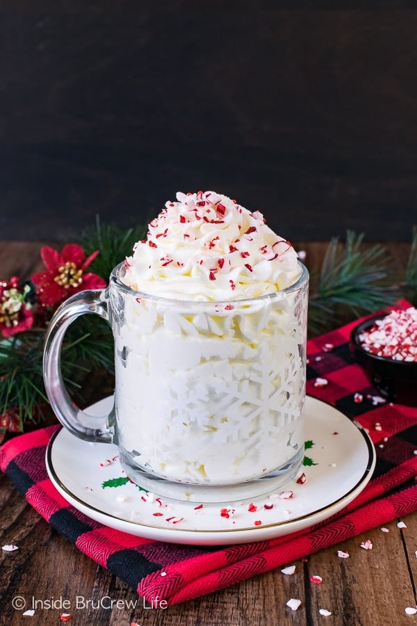 Peppermint Whipped Cream - a batch of this homemade whipped cream is perfect for most Christmas desserts. Great recipe for holiday parties!