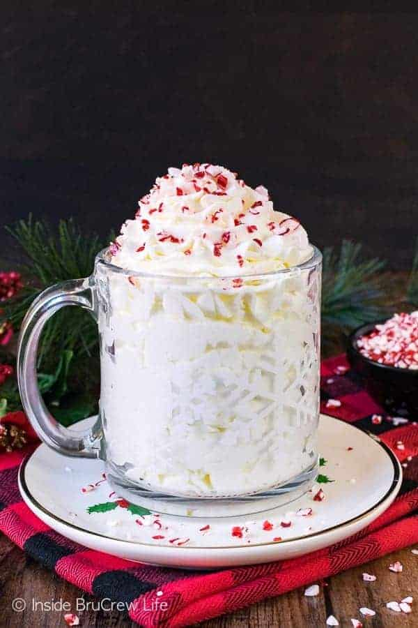 Peppermint Whipped Cream - this easy and creamy topping is perfect for adding to most Christmas desserts. Great recipe for holiday parties!