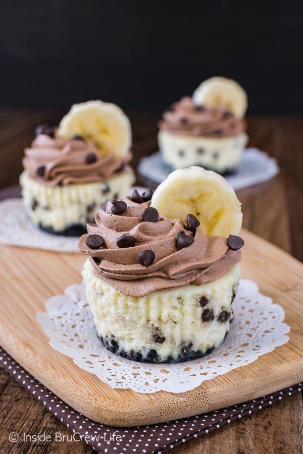 Banana Chocolate Chip Cheesecakes - mini banana cheesecakes loaded with chocolate chips and topped with homemade chocolate whipped cream. Awesome recipe for parties!