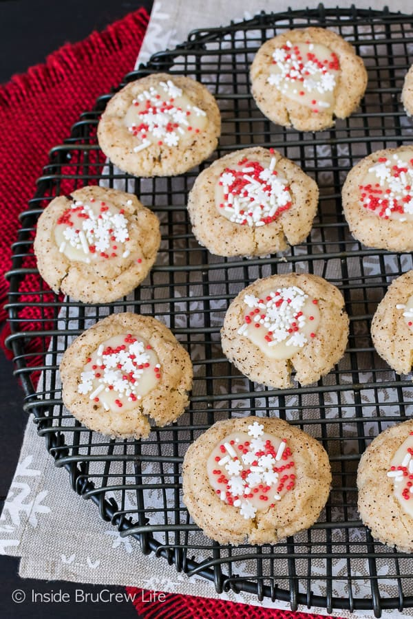 Eggnog Thumbprints - a sweet eggnog chocolate and sprinkles fill in the center of these spice cookies. Great recipe for Christmas cookie trays!