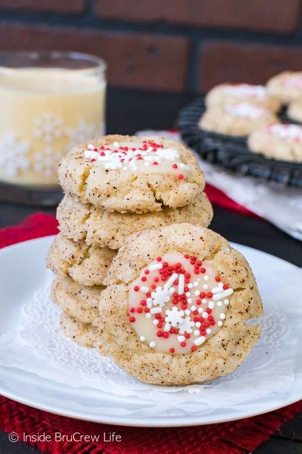 Eggnog Thumbprints - little spice cookies filled with an eggnog chocolate and sprinkles. Easy recipe for holiday cookie exchanges!