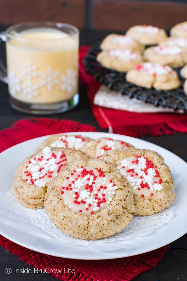 Eggnog Thumbprints - sprinkles and eggnog chocolate fill the centers of an easy spice cookie. Great recipe for Christmas cookie trays!
