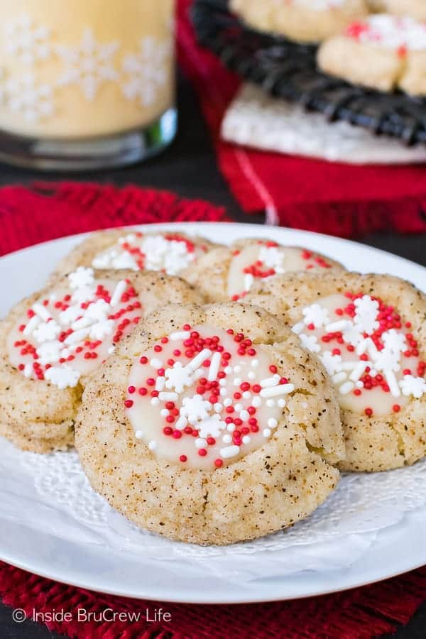 Eggnog Thumbprints - simple little spice cookies filled with an eggnog chocolate and sprinkles. Easy recipe for Christmas cookie trays!