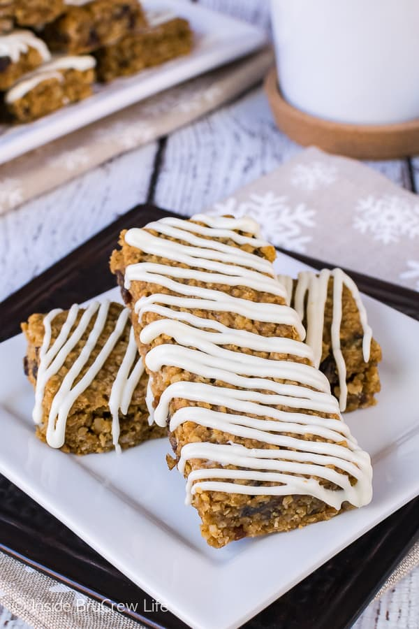Iced Gingerbread Oatmeal Bars - start your day off with these easy baked oatmeal bars. Great recipe for breakfast or after school snacks!