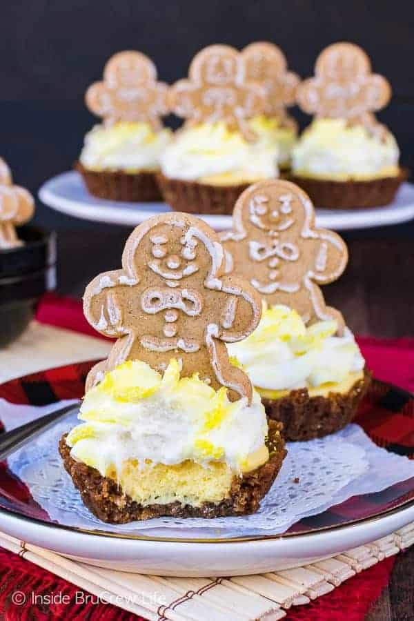 Lemon Gingersnap Cheesecake Tarts - spicy cookie crusts filled with a fluffy lemon mousse and topped with a little gingerbread cookie makes a cute holiday dessert. Easy recipe for Christmas parties!