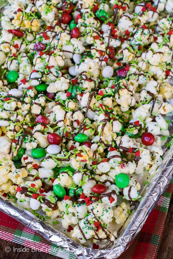Mint Grinch Popcorn - easy snack mix loaded with mint candies and sprinkles. Great recipe to make for movie night!