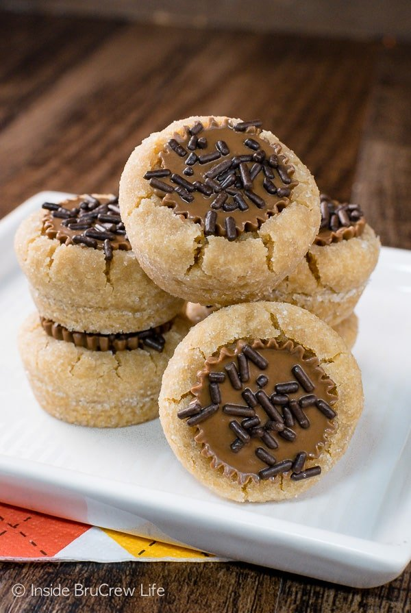Peanut Butter Cup Cookies - a soft peanut butter cookie filled with a peanut butter cup is a fun treat. Make this cookie for all your holiday parties! #cookies #peanutbuttercups #holiday #christmas