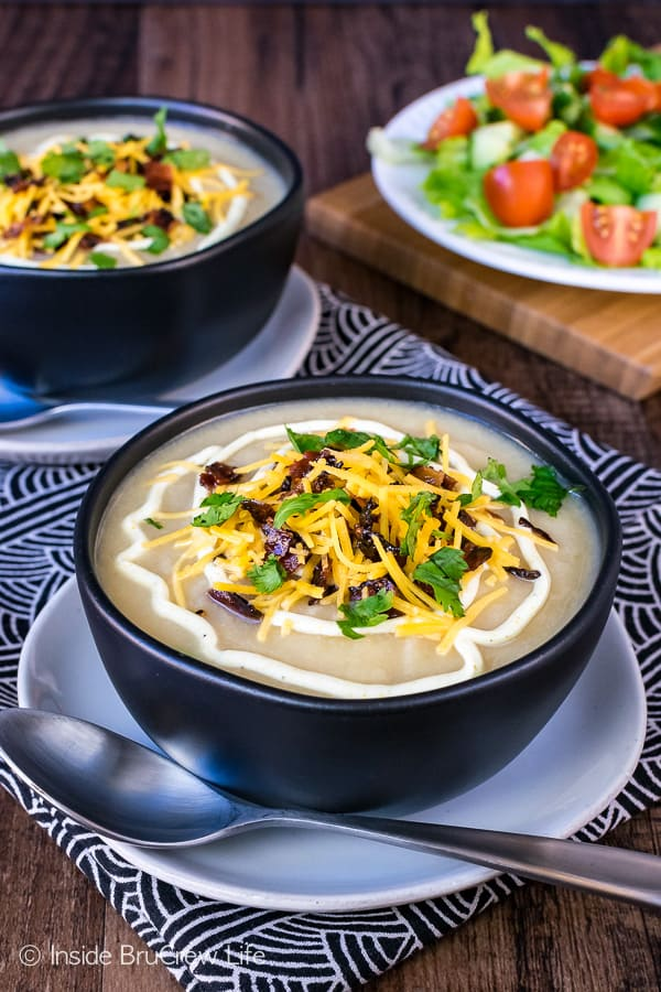Loaded Cauliflower Soup - the base of this creamy soup is made from cauliflower. Add cheese and bacon to top it off. Easy healthy recipe that tastes like comfort food!