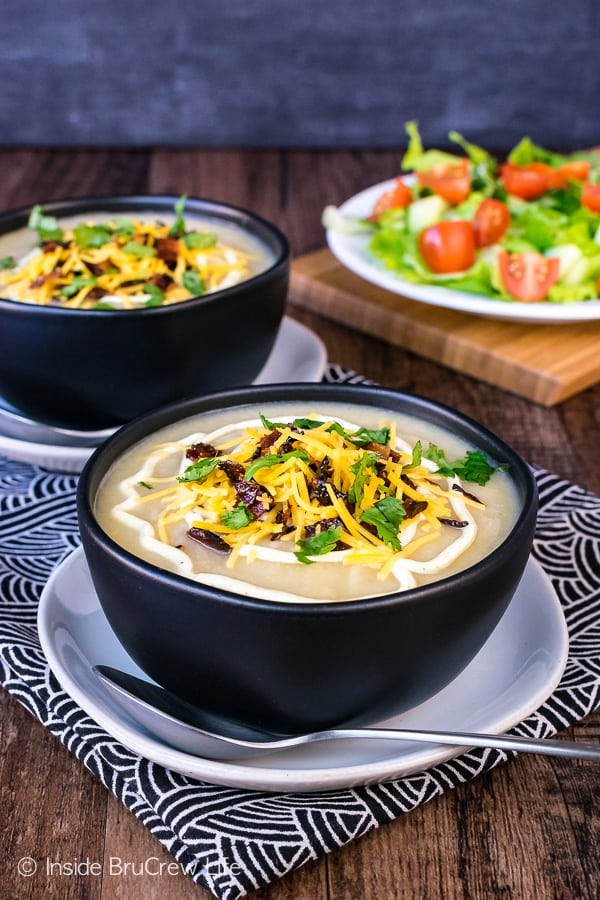 Loaded Cauliflower Soup - no one will even know you used veggies in this creamy and delicious soup recipe. This easy healthy bowl of soup looks and tastes just like comfort food.