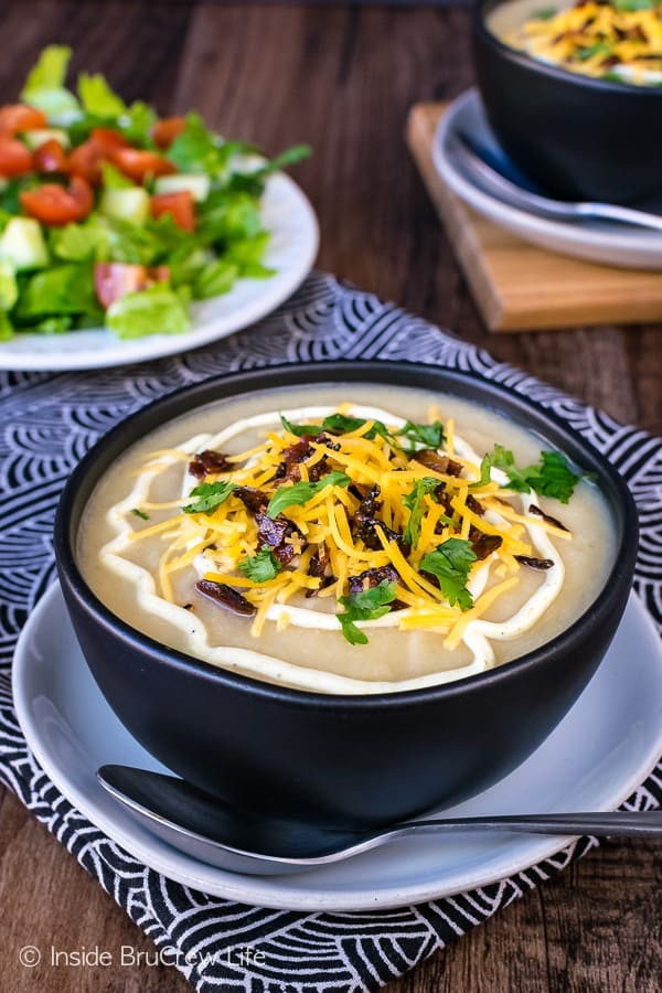 Loaded Cauliflower Soup - this easy soup is loaded with lots of veggies and topped with cheese and bacon. Great comfort food recipe that is healthy!